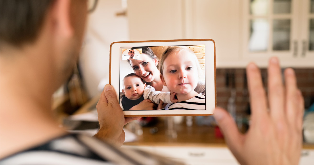 A family meets by video conference while separated, to stay safe.