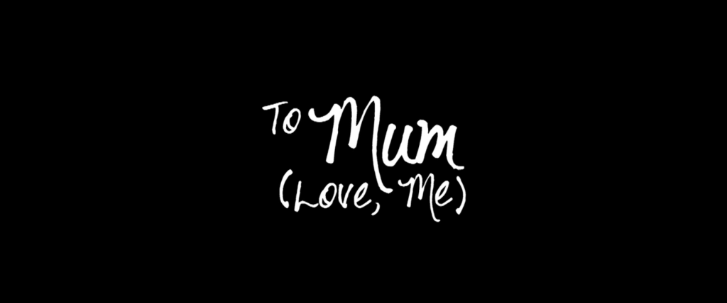 "A black background with white text reading ""To Mum (Love, Me)"" in handwriting."
